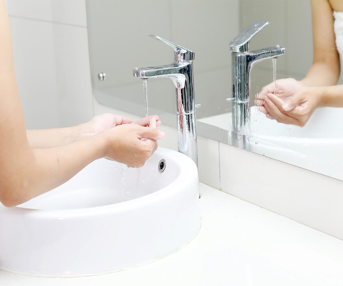 Running Water Into Woman's Hand